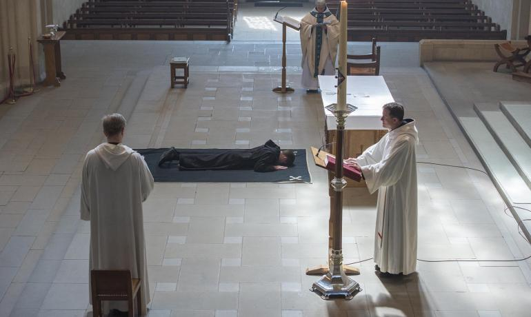 Br Joseph Benedict prostrate on the pall